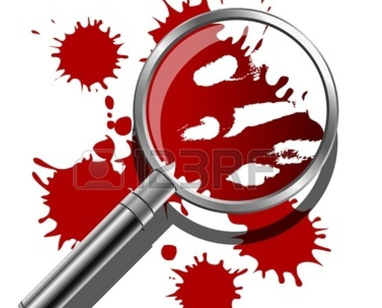 18263604-a-magnifying-glass-being-used-to-inspect-the-bloody-evidence-of-a-crime-scene